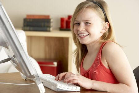 11 year old girl: Young Girl Using Computer At Home