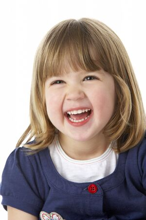 mischievious: Studio Portrait Of Laughing Young Girl