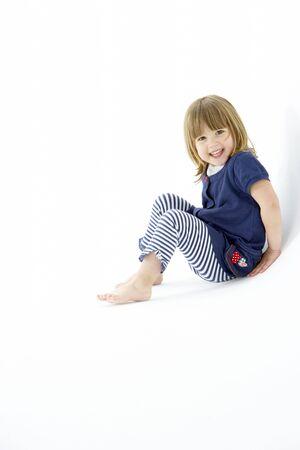 mischievious: Young Girl Sitting In WhiteStudio