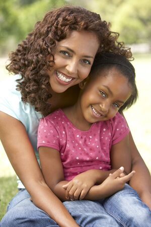 african american mother and daughter: Portrait Of Mother And Daughter In Park