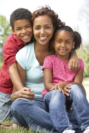 Mother With Children In Park photo
