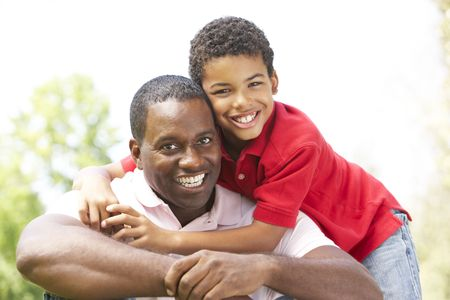 Portrait Of Father And Son In Park photo