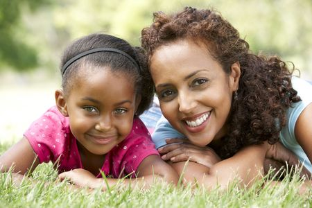 african mother: Portrait Of Mother And Daughter In Park