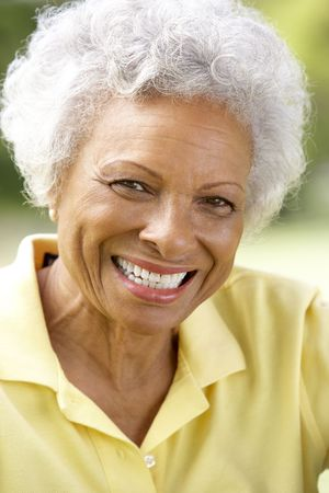 Portrait Of Smiling Senior Woman Outdoors photo