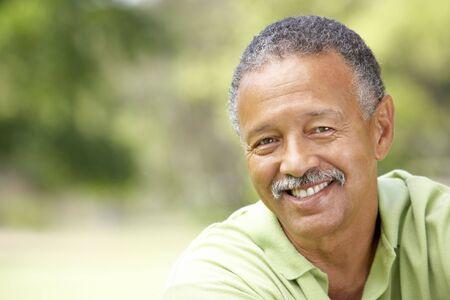three men: Portrait Of Senior Man In Park Stock Photo