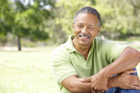 and the horizontal man: Portrait Of Senior Man In Park Stock Photo