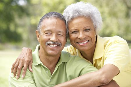male senior adult: Portrait Of Senior Couple In Park Stock Photo