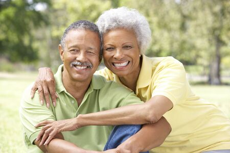 african american: Portrait Of Senior Couple In Park Stock Photo