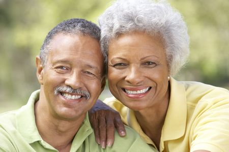 older person: Portrait Of Senior Couple In Park Stock Photo