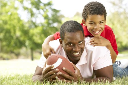 Father And Son In Park With American Football Stock Photo - 6456411