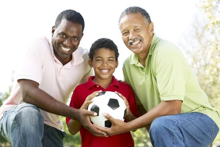granddad: Grandfather With Son And Grandson In Park With Football