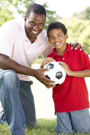 Father And Son In Park With Football photo
