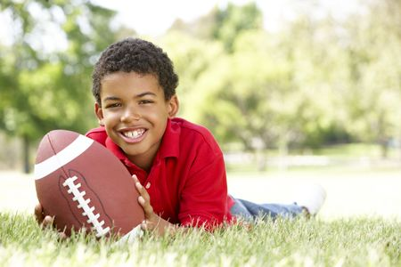 Boy In Park With American Football photo