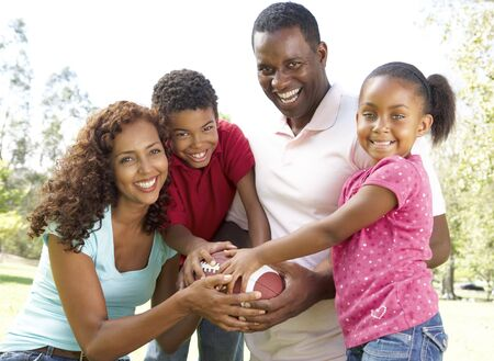 Family In Park With American Football Stock Photo - 6456484
