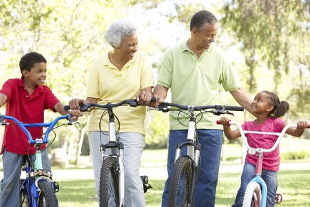 Grandparents In Park With Grandchildren Riding Bikes photo