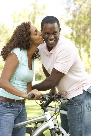 Couple On Cycle Ride in Park photo