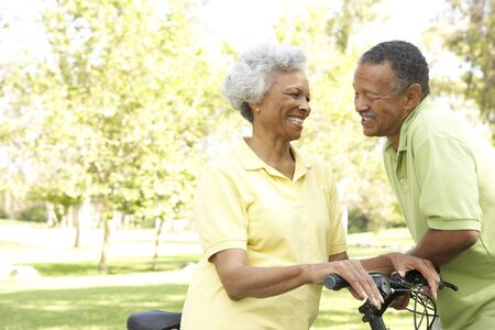 Senior Couple Riding Bikes In Park photo