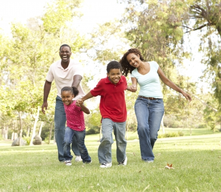 home run: Family Enjoying Walk In Park