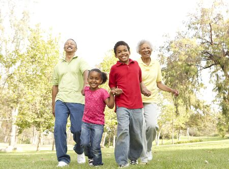 Grandparents In Park With Grandchildren photo