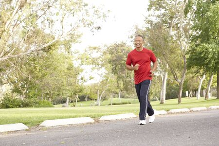 Senior Man Jogging In Park Stock Photo - 6456474