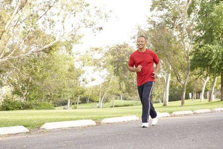 Senior Man Jogging In Park Stock Photo - 6456474