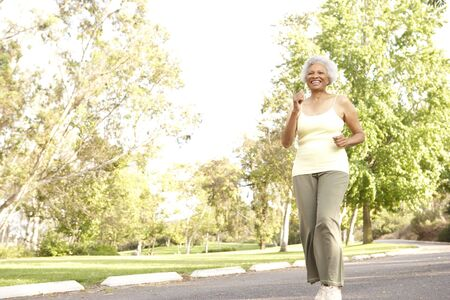 Senior Woman Jogging In Park Stock Photo - 6456570