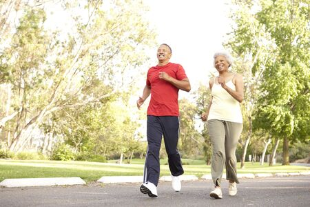 Senior Couple Jogging In Park Stock Photo - 6456323