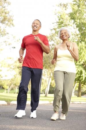 Senior Couple Jogging In Park photo