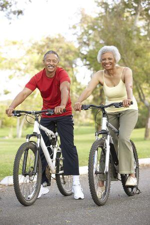 Senior Couple Riding Bikes In Park photo