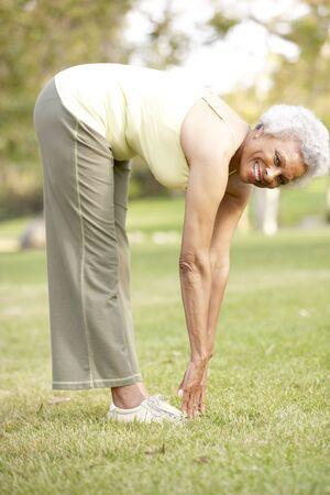 Senior Woman Exercising In Park Stock Photo - 6456431