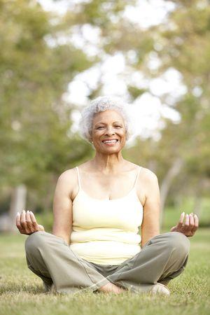 Senior Woman Doing Yoga In Park Stock Photo - 6456117