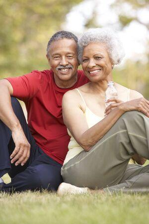 senior exercising: Senior Couple Resting After Exercise Stock Photo