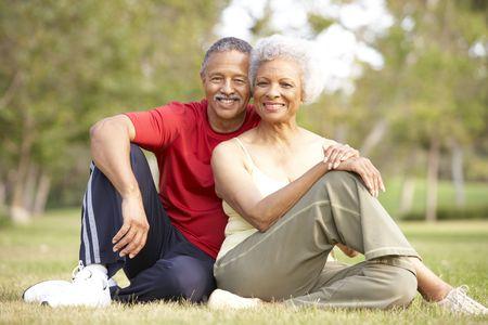 couple exercising: Senior Couple Resting After Exercise Stock Photo