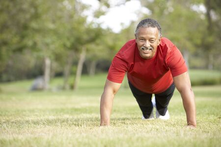 exercising: Senior Man Exercising In Park