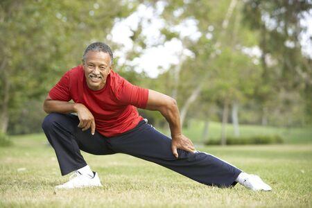 men exercising: Senior Man Exercising In Park