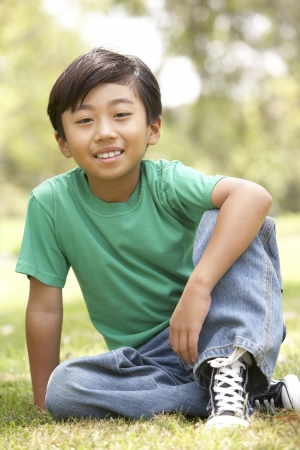 filipino people: Portrait Of Young Boy In Park Stock Photo