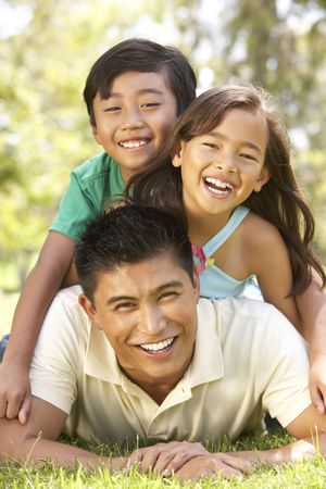 Father And Children Enjoying Day In Park photo