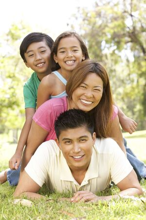 happy asian family: Family Enjoying Day In Park