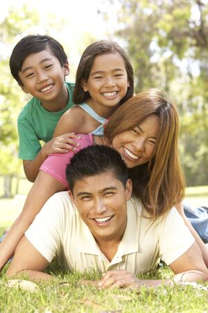 filipino people: Family Enjoying Day In Park