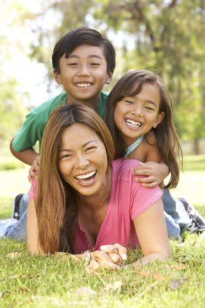 Mother And Children Enjoying Day In Park photo
