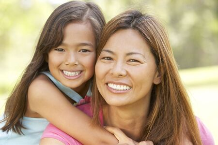 filipino people: Mother And Daughter Enjoying Day In Park Stock Photo