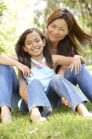 Mother And Daughter Enjoying Day In Park photo
