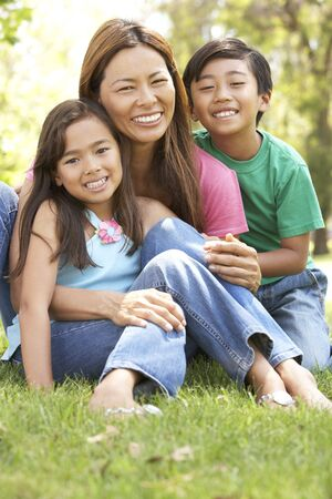 filipino people: Mother And Children Enjoying Day In Park