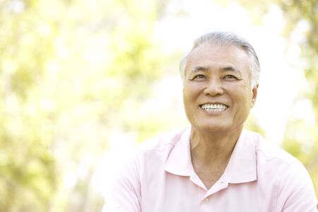 Portrait Of Senior Man In Park photo