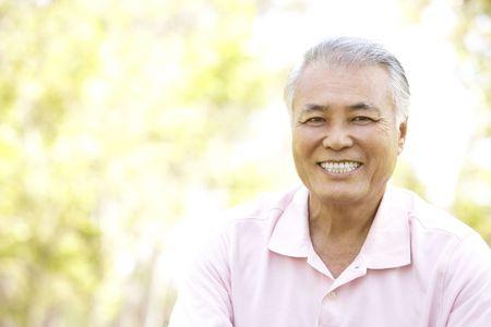 asian senior: Portrait Of Senior Man In Park Stock Photo