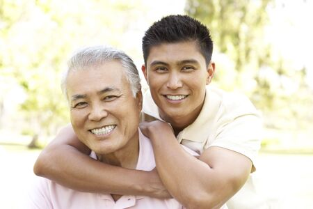 Father With Adult Son In Park photo