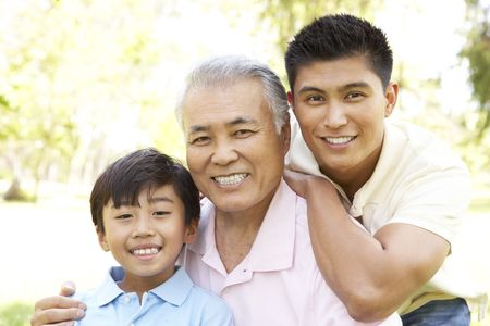 sons and grandsons: Grandfather With Son And Grandson In Park Stock Photo