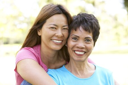 Senior Woman With Adult Daughter In Park photo