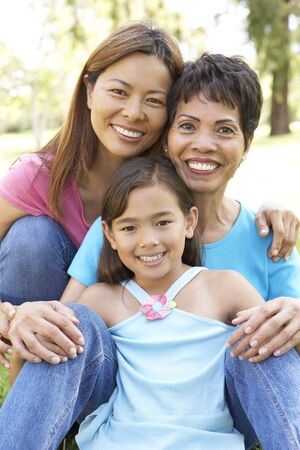 Grandmother With Daughter And Granddaughter In Park photo