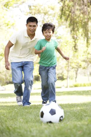 Father And Son In Park With Football Stock Photo - 6456350